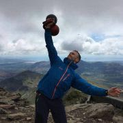 Rob performs a double 24kg Stacked Press on Snowdon